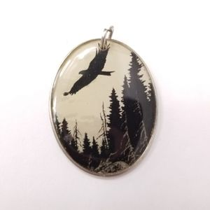 Round Black bird pendant